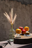 Still life with flower foxtail weed in glass bottles and fruits Royalty Free Stock Photos