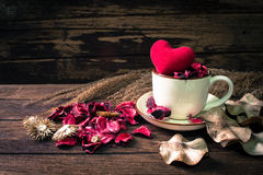 Still life with flower sachet & a cup Stock Photos