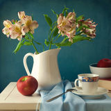 Still life with flowers and apple Royalty Free Stock Image