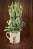 Still life of flowers and ears of rye in vintage vase with keys. Royalty Free Stock Image