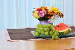 Still life with flowers and fruit Stock Image