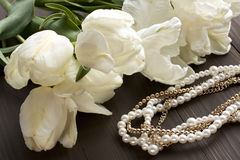 Still life with flowers and pearl necklace Stock Photos