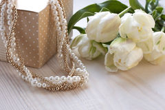 Still life with flowers and pearl necklace Royalty Free Stock Image