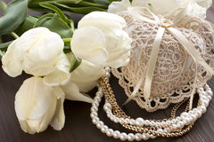 Still life with flowers and pearl necklace. Holidays composition with gift set Royalty Free Stock Photo