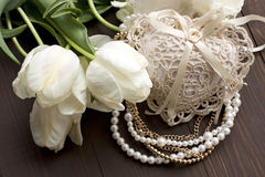 Still life with flowers and pearl necklace Stock Photo