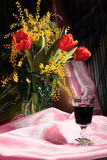 Still life with flowers and red wine Stock Photography
