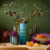 Still life with flowers and tangerines Stock Images