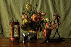 Still life with flowers, timer  and retro camera Royalty Free Stock Image