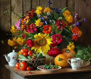 Still life with flowers and vegetables. Augustus. Stock Image