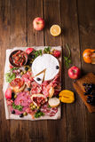 Still life, food and drink, holidays concept. Assortment of spanish tapas or italian antipasti jamon, prosciutto, chorizo, salami Royalty Free Stock Photography