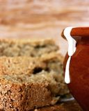 Still life of food. Homemade bread with a pot and sour cream Royalty Free Stock Image