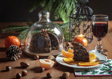 Still life or food Photo Christmas pudding. New Year holiday, English traditional dessert on a wooden table on a white vintage plate decorated with slices of royalty free stock images