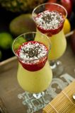 Banana and mango smoothie dessert in wine glasses Royalty Free Stock Images