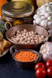 Still life food set on dark background. Concept shealthy eating. Lentils, nut, chickpeas, cheese, garlic, mushrooms, cherry tomato royalty free stock photos