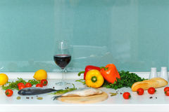 Still life. Food. Vegetables, bread, wine and fish. Stock Image