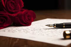 Still life of a fountain pen, paper and flowers roses Royalty Free Stock Image