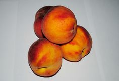 Peaches nectarines on a white background, macro royalty free stock photography