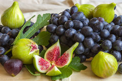 Still life of fresh colorful fruits. Bunch of black grapes, gree Royalty Free Stock Photo