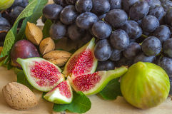 Still life of fresh colorful fruits. Bunch of black grapes, gree Royalty Free Stock Photography