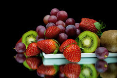 Still life of fresh fruit on a black background Royalty Free Stock Photos