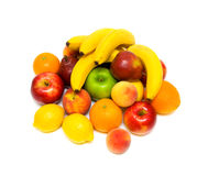 Still life of fresh fruit on a white background. Bananas, oranges, apples, pears, peaches, lemons and apricots Stock Photography