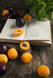 Still life with fresh fruits and vintage books Royalty Free Stock Photography