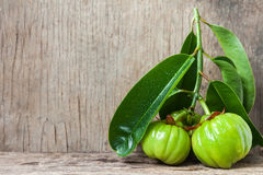 Still life with fresh garcinia cambogia on wooden background (Th Royalty Free Stock Images