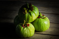 Still life with fresh garcinia cambogia on wooden background (Th Royalty Free Stock Photography