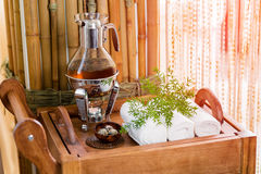 Still life fresh, hot herbal tea on a tray with towels and herbs in the spa. Royalty Free Stock Photography
