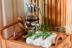 Still life fresh, hot herbal tea on a tray with towels and herbs in the spa. Royalty Free Stock Photos