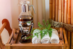 Still life fresh, hot herbal tea on a tray with towels and herbs in the spa. Royalty Free Stock Image