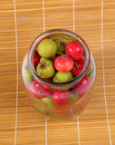 Still-life with fresh natural red rowan berries and small green pears Stock Photo