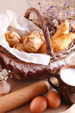 Still life with fresh pastries and a cup of milk Royalty Free Stock Photography