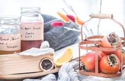 Still life fresh persimmon. In a basket on a serving table preparation for breakfast concept of holding Royalty Free Stock Photography