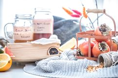 Still life fresh persimmon. In a basket on a serving table preparation for breakfast concept of holding Royalty Free Stock Images
