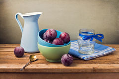 Still life with fresh plums Stock Photo