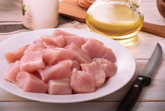 Still life with fresh raw chicken fillet. And condiment Royalty Free Stock Photos