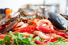 Still life with fresh raw seafoods. And fish in domestic kitchen Stock Photo