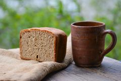 Still life, Fresh rye bread and old potter mug Stock Photos