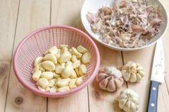 Still life with fresh sliced garlic in basket Stock Image