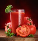 Still-life of fresh tomatoes and its juice. Royalty Free Stock Photography