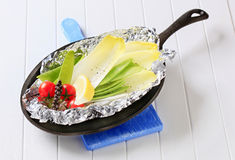 Fresh vegetables on tinfoil in skillet Royalty Free Stock Photo
