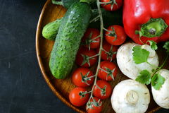 Still life of fresh vegetables (tomatoes, mushrooms, peppers, cucumbers) Royalty Free Stock Images