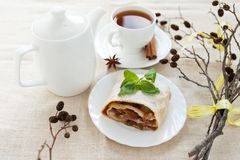 Still-life with freshly baked apple pie, tea and dry branch Stock Photography