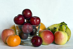 Still life of fruit. A still life of fruit and a glass bowl Stock Images