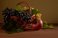 Still life fruit basket. On the table Stock Photography