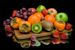 Still life of fruit on a black background Royalty Free Stock Photos