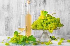Still life fruit bottlle wine grapes Royalty Free Stock Images