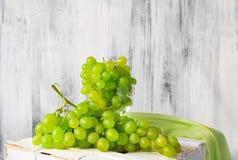 Still life fruit bottlle wine grapes Stock Image