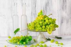 Still life fruit bottlle wine grapes Stock Images